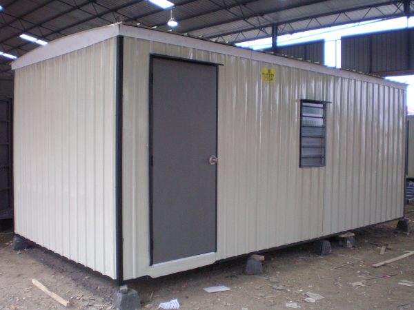 white light duty portable cabin inside a warehouse