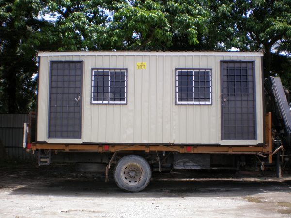 white light duty portable cabin on a trailer